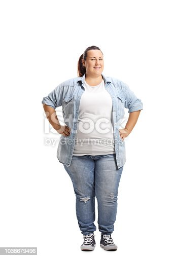 Overweight woman standing with hands on her waist isolated on white background