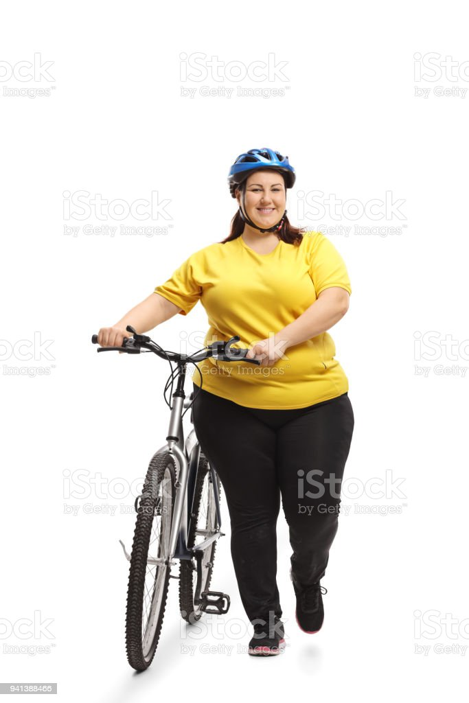 Full length portrait of an overweight woman with a bicycle walking...