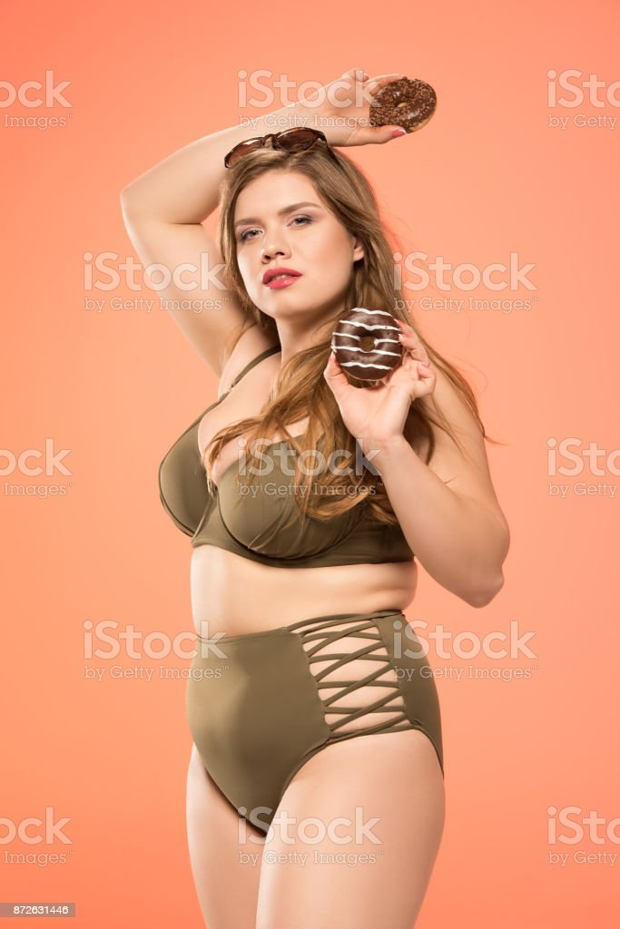 overweight woman with donuts stock photo