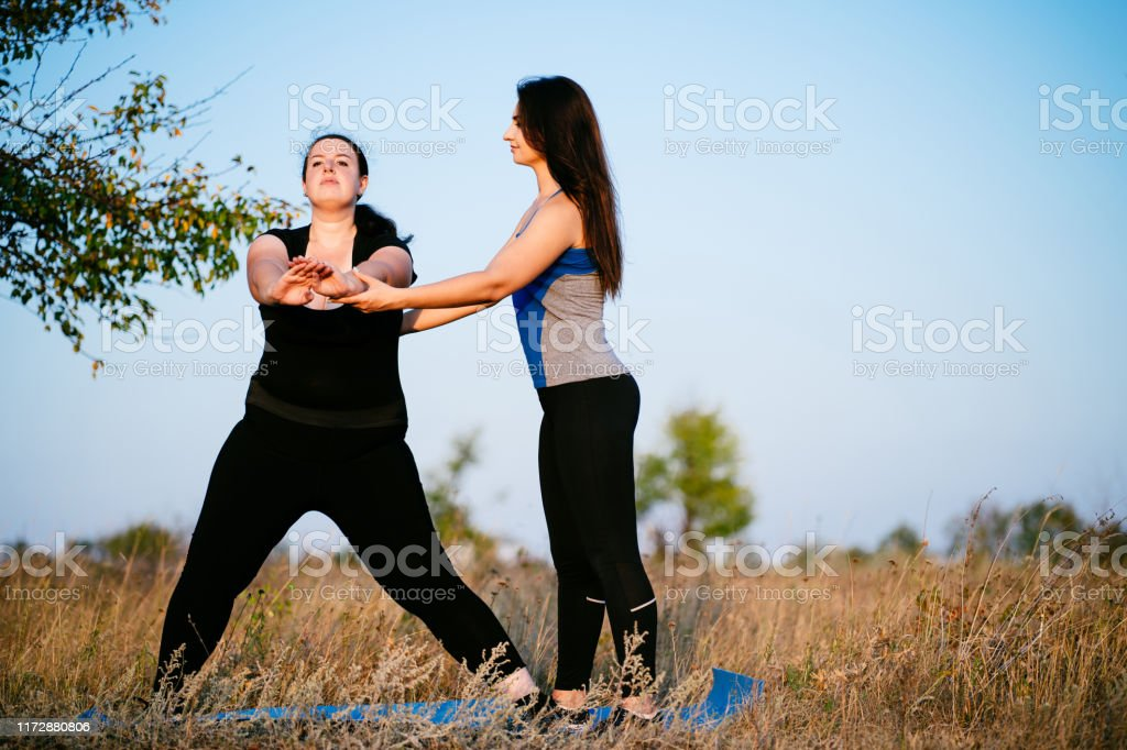 Overweight Woman Working Out With Personal Trainer Stock Photo Download Image Now Istock