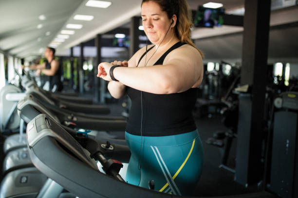 Overweight women at gym stock photo