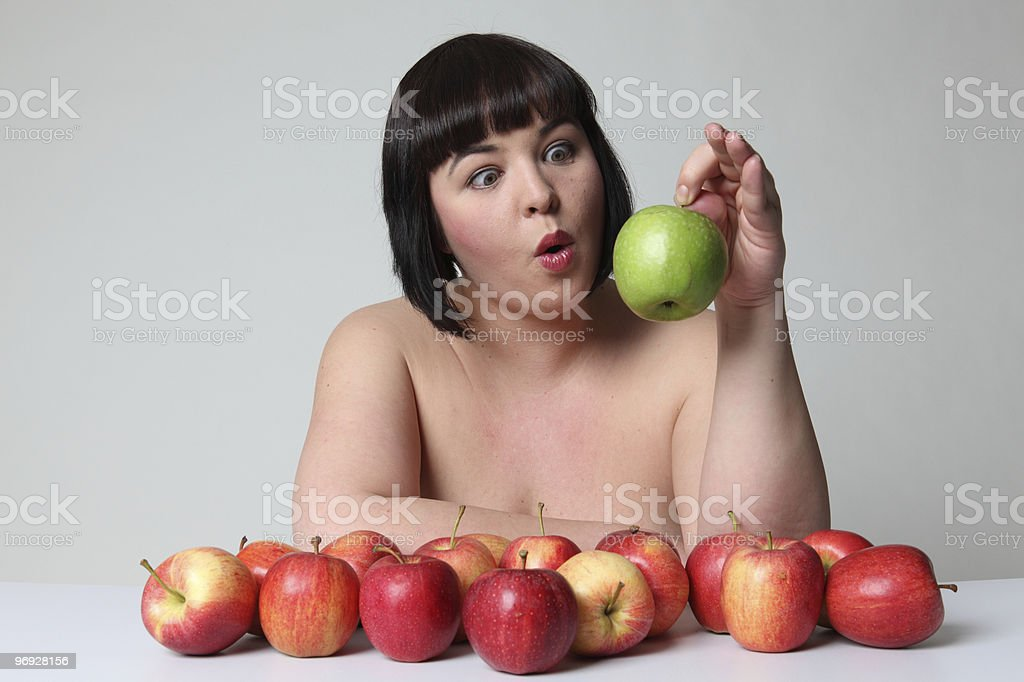 Overweight women with apples royalty-free stock photo