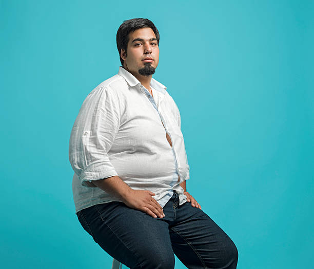 overweight young man - stomach sitting stock photos and pictures