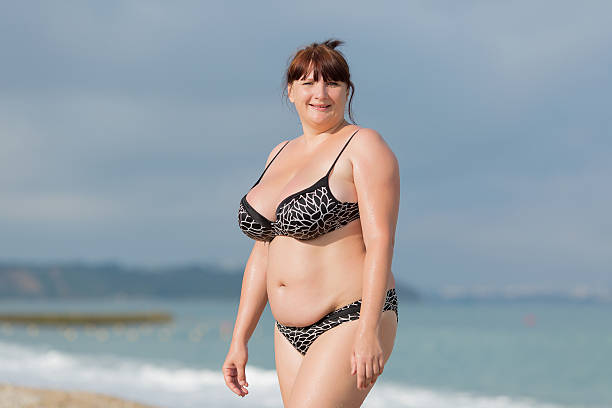overweight young woman at the sea - curvy voluptuous women stock photos and pictures
