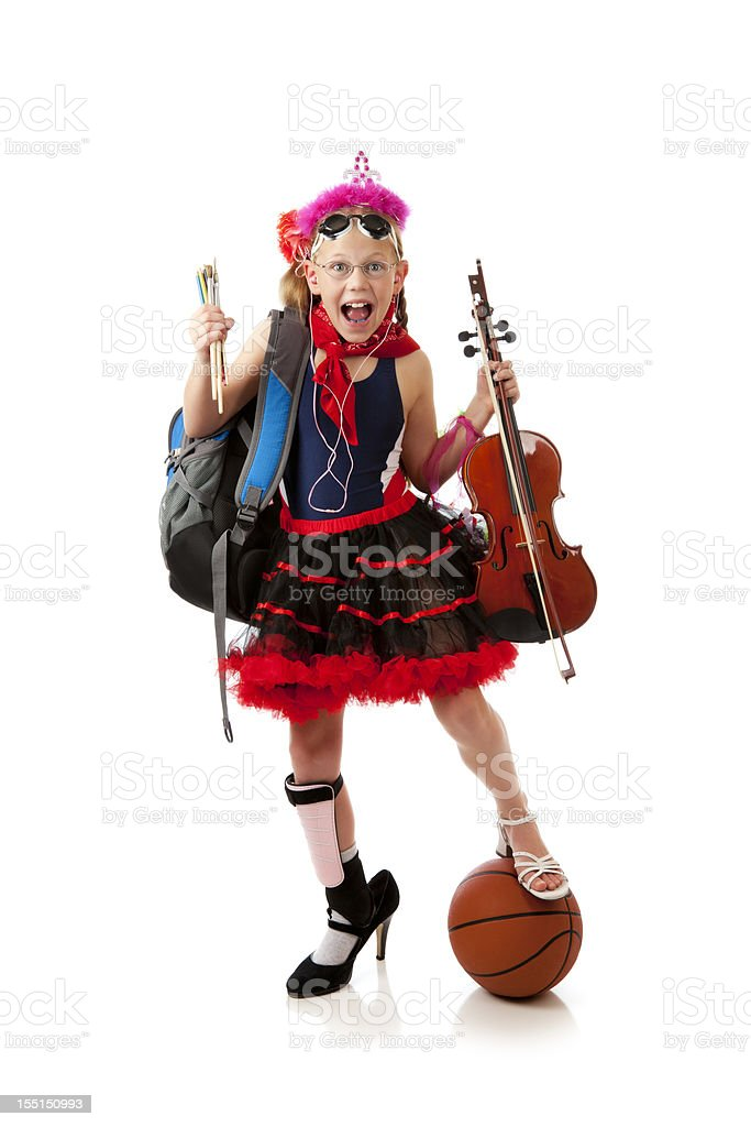 Overwhelemed child in too many activities stock photo