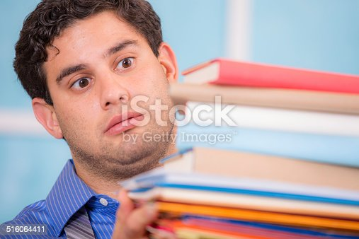 481644192 istock photo Overwhelmed business man holding large stack of files, books, paperwork. 516064411