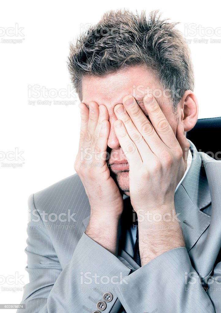 overwhelmed businessman at the office stock photo