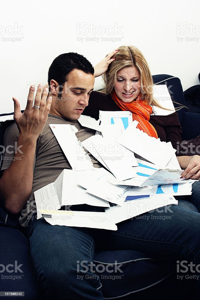 Overwhelmed by bills royalty-free stock photo