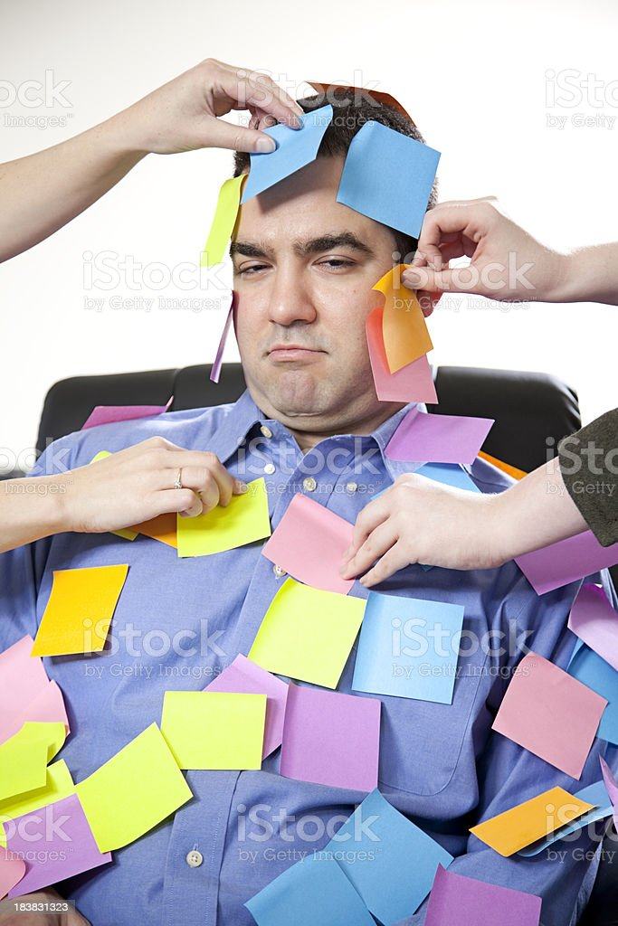 Overwhelmed executive with sticky notes royalty-free stock photo