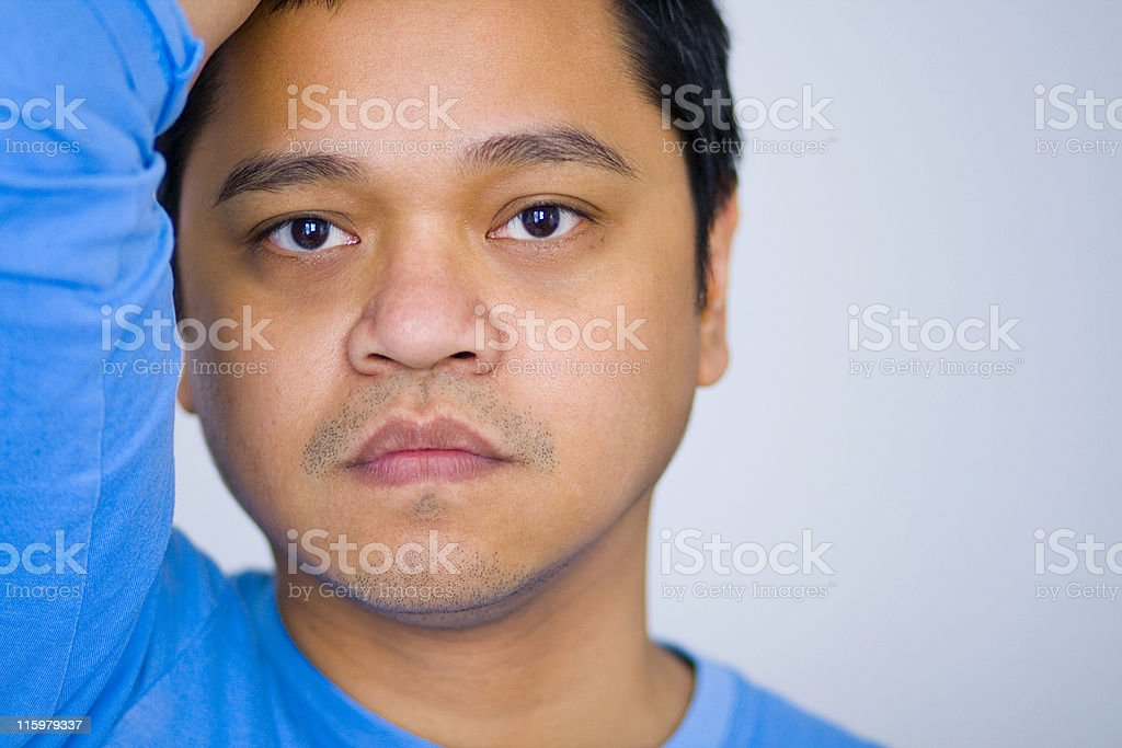 Overwhelmed Close-up of handsome Asian man with a worried look on his face. 30-39 Years Stock Photo