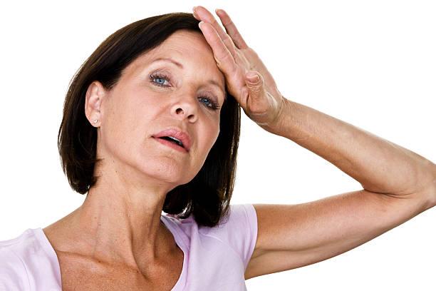 overwhelmed woman - mature woman fever on white bildbanksfoton och bilder