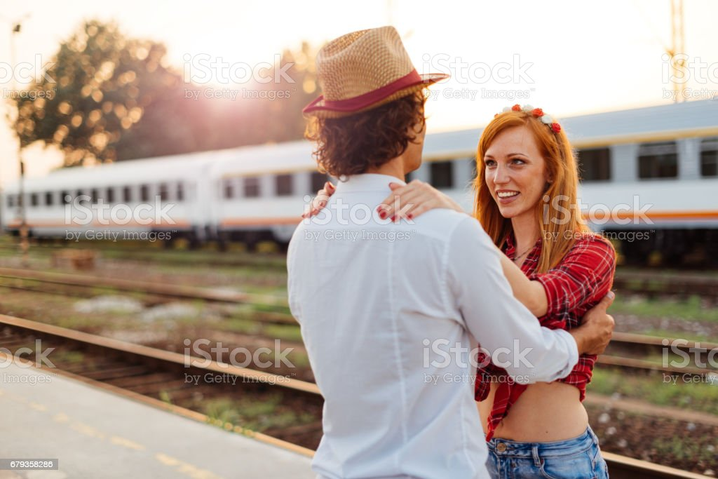 Overwhelming emotions between man and woman on railway station royalty-free stock photo