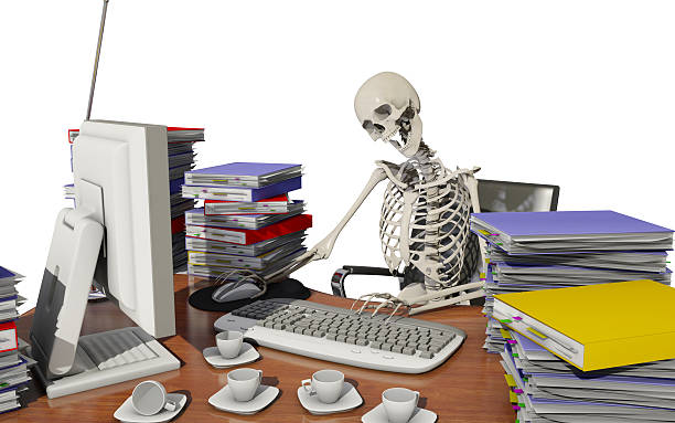 overwork death - human skeleton stock photos and pictures