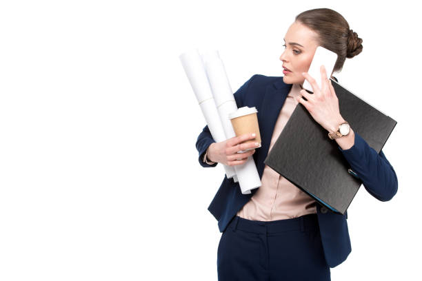 overworked adult businesswoman with lot of paperwork and coffee to go talking by phone isolated on white overworked adult businesswoman with lot of paperwork and coffee to go talking by phone isolated on white multi tasking stock pictures, royalty-free photos & images