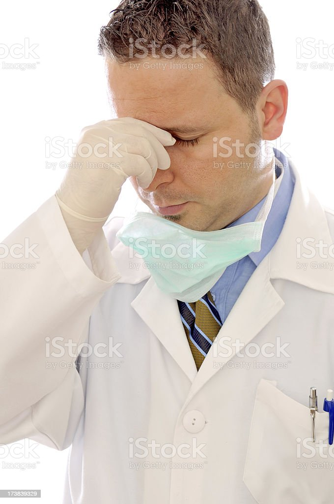 Overworked and tired Doctor stock photo