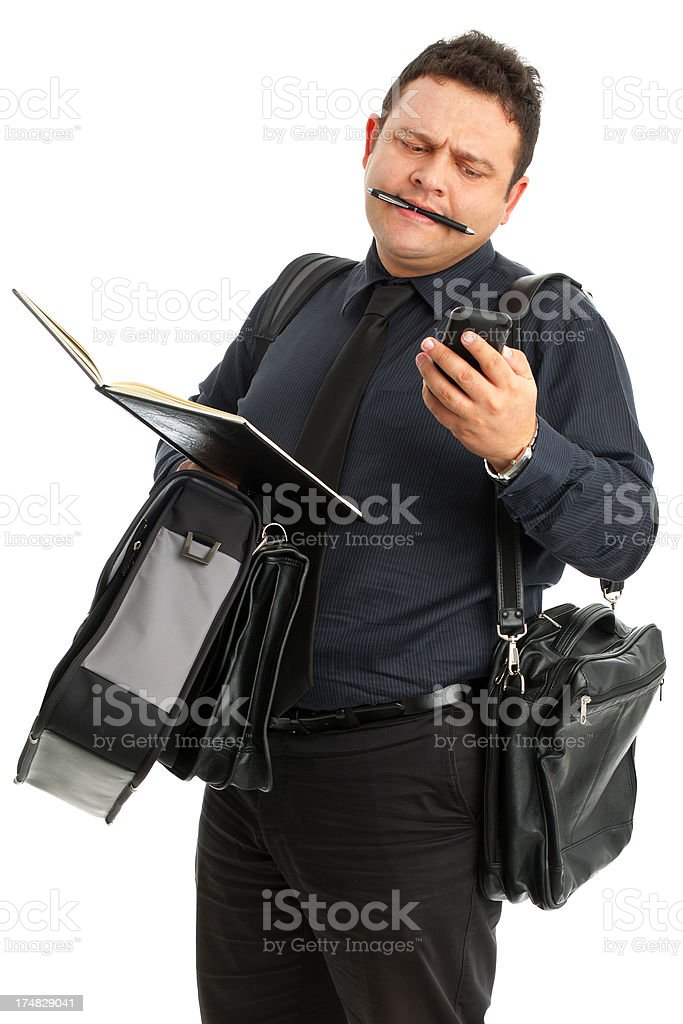 Overworked Business man looking smart phone royalty-free stock photo