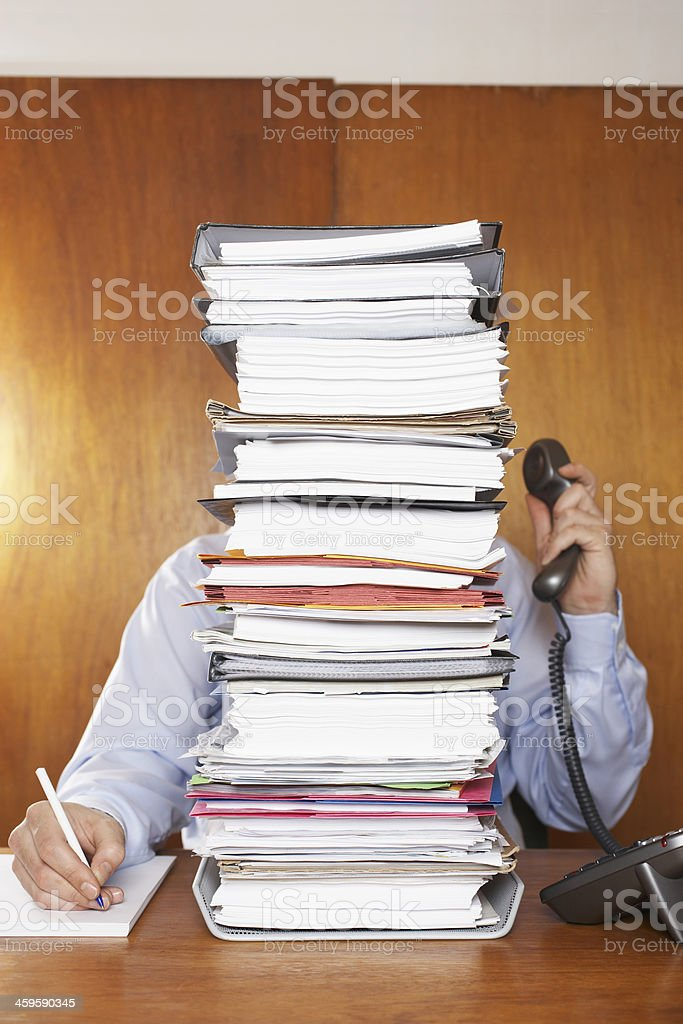Overworked Businessman At Desk stock photo