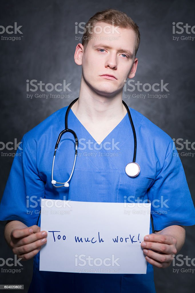 Overworked by many duties stock photo