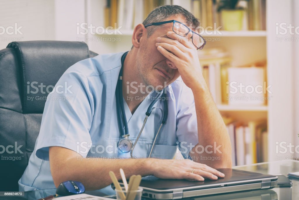 Overworked doctor in his office royalty-free stock photo