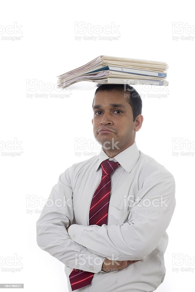 Overworked Indian businessman displaying Expressions of boredom and burnout. royalty-free stock photo