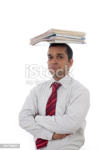 istock Overworked Indian businessman displaying Expressions of boredom and burnout. 184766521