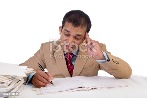 istock Overworked Indian businessman displaying Expressions of boredom and burnout. 184901895