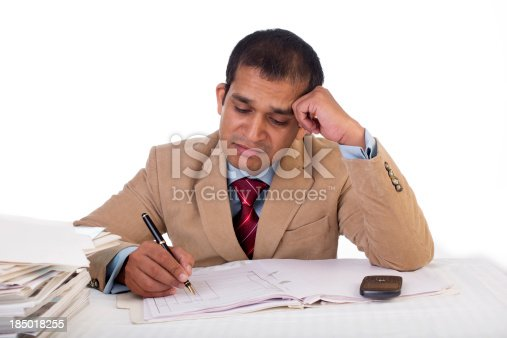istock Overworked Indian businessman displaying Expressions of boredom and burnout. 185018255