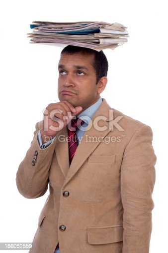 istock Overworked Indian businessman displaying Expressions of despair, boredom and burnout. 186052559