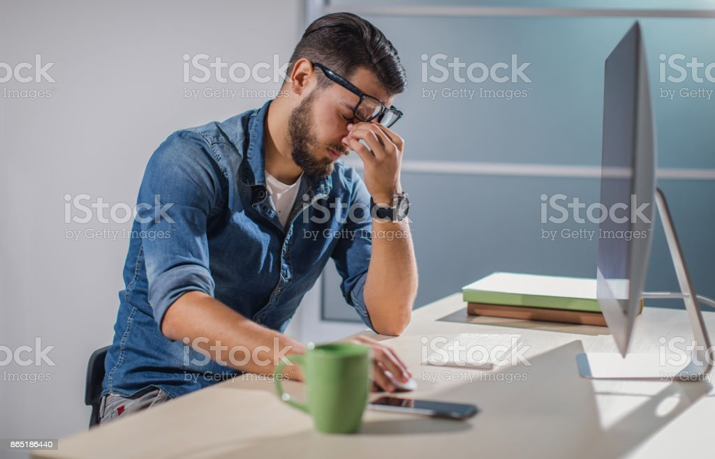 Overworked man stock photo