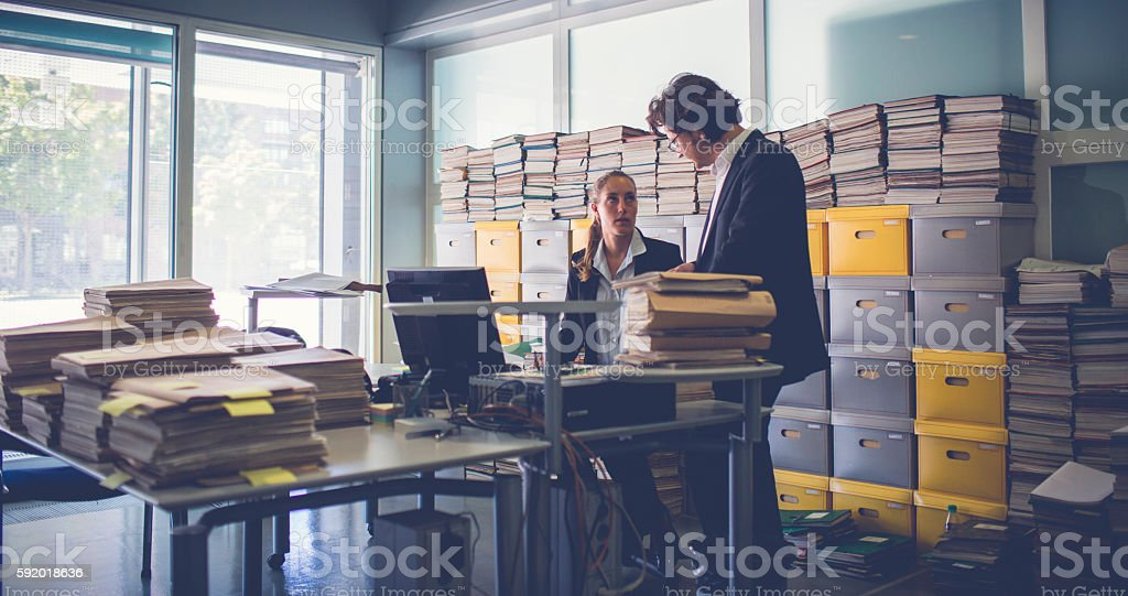Overworked office workers, bureaucracy, archives - foto stock