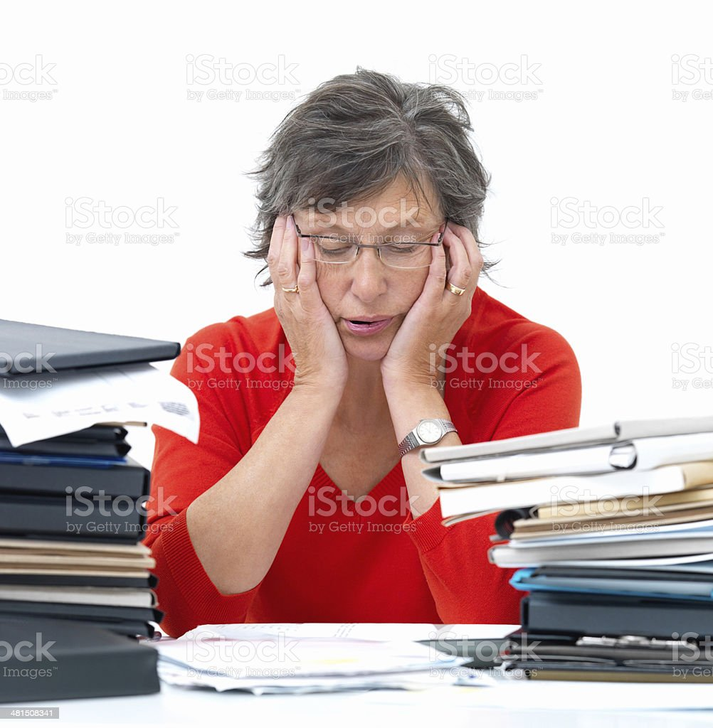 Overworked woman stressed with work royalty-free stock photo