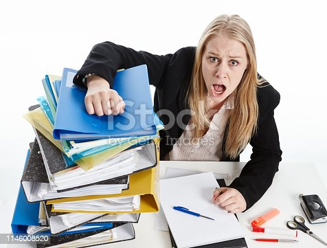 187928332 istock photo Overworked young blonde office worker shouts in angry frustration 1146008520