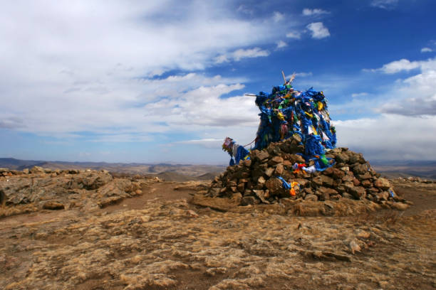Ovoo with sacred silk scarves in Tovkhon Monastery, Ovorkhangai Province, Mongolia. UNESCO World Heritage Site. stock photo