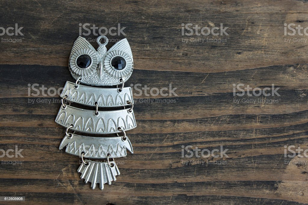 Owl Pendant Necklace on Rustic Wooden Background stock photo