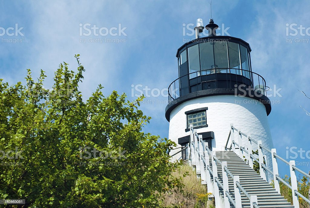 Owl's Head Light in Maine with blue sky stock photo