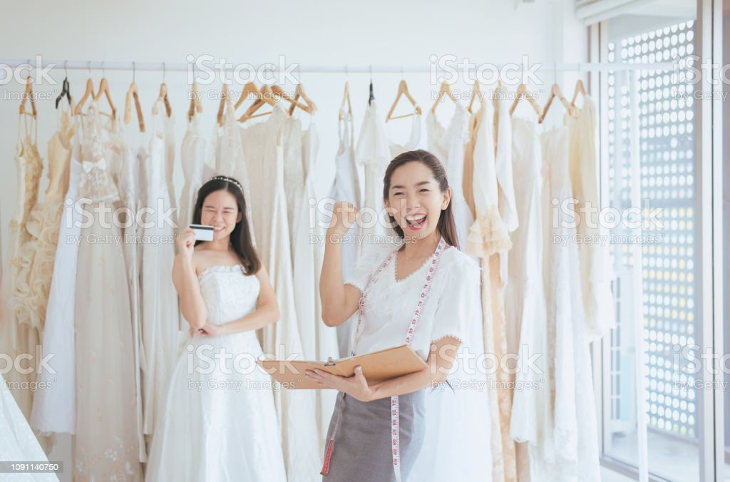 Owner Asian Woman Of Wedding Shop Success Package And Sale Finish