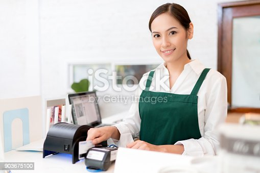 istock Owner Credit card is used to pay for food and coffee. 903675100