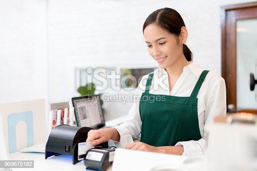 istock Owner Credit card is used to pay for food and coffee. 903675182