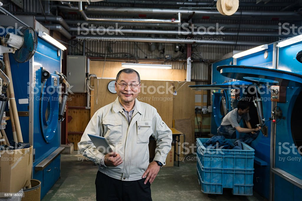 Owner of a large textile factory with digital tablet stock photo