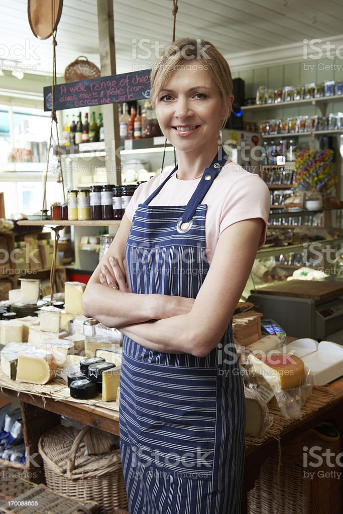 Owner Of Delicatessen Standing In Shop royalty-free stock photo