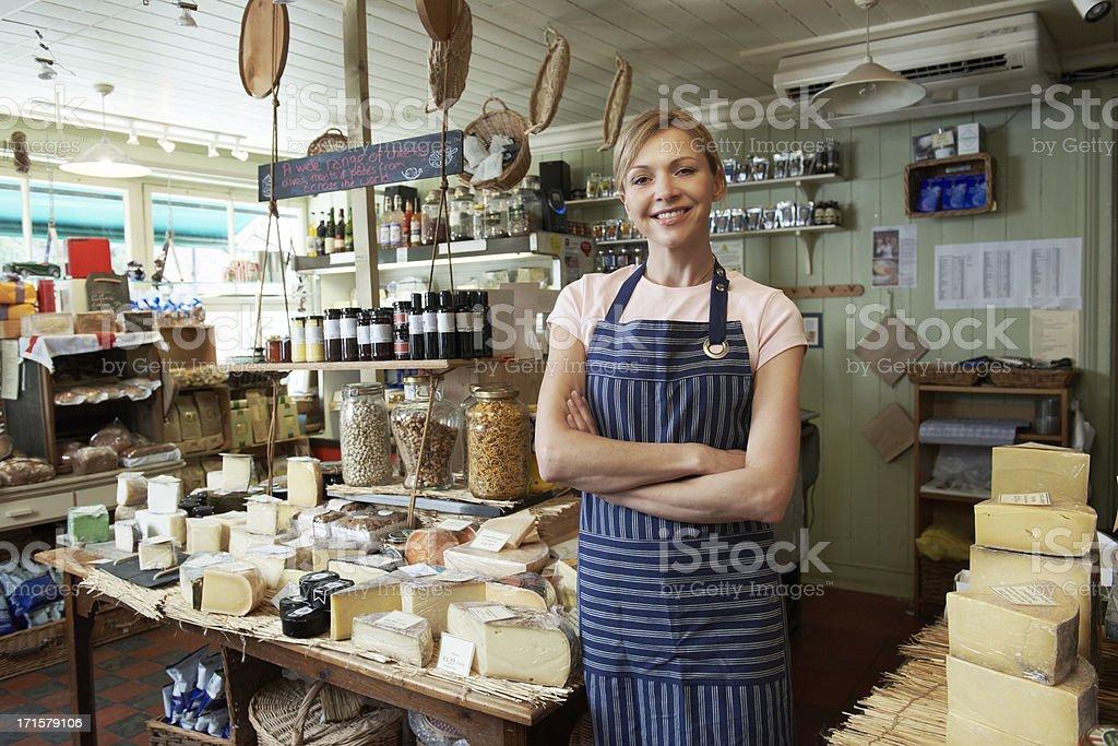 Owner Of Delicatessen Standing In Shop stock photo