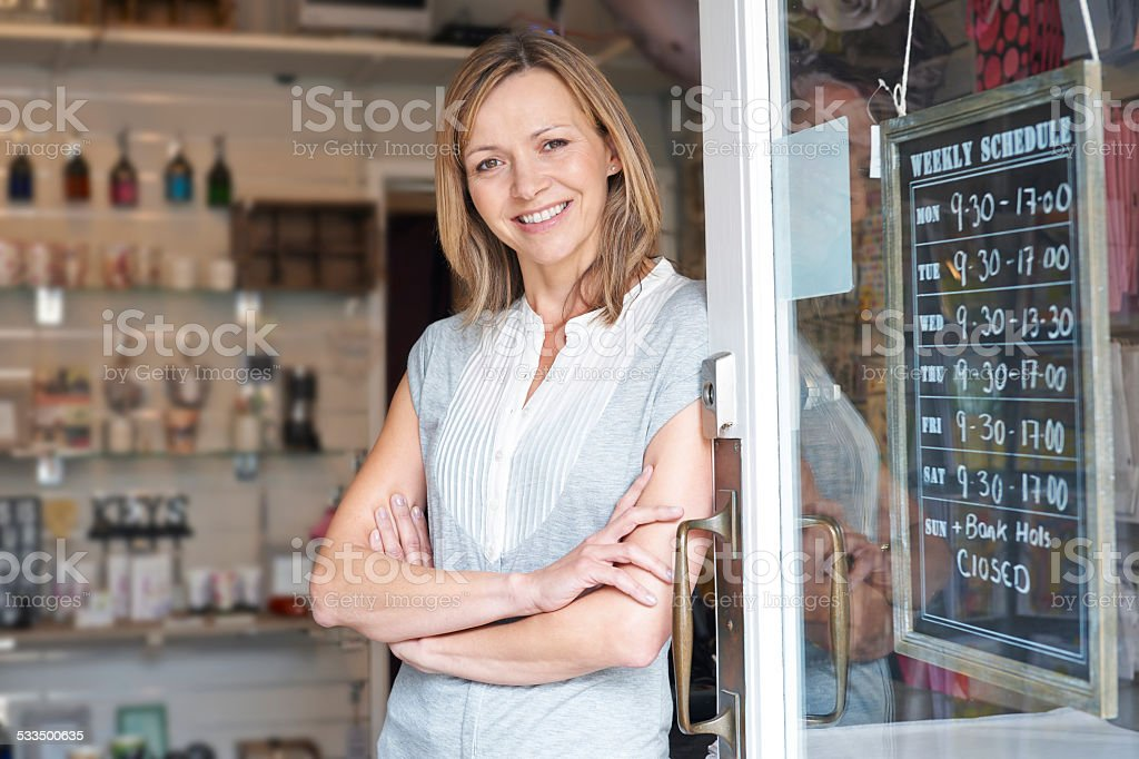 Owner Of Gift Shop Standing In Doorway stock photo
