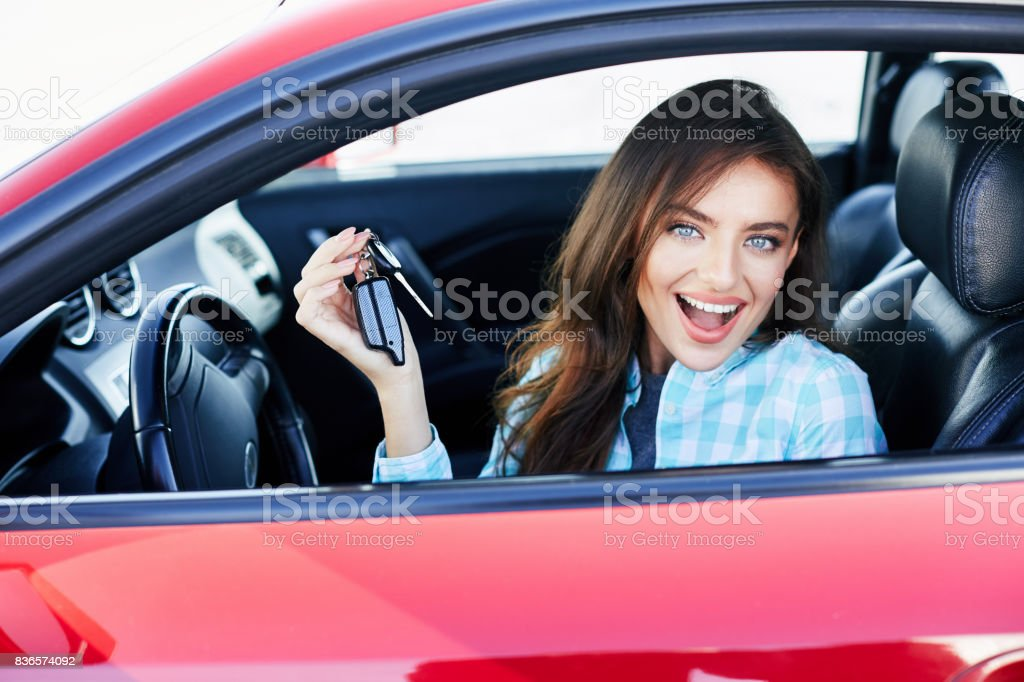 Owner of new car with keys stock photo