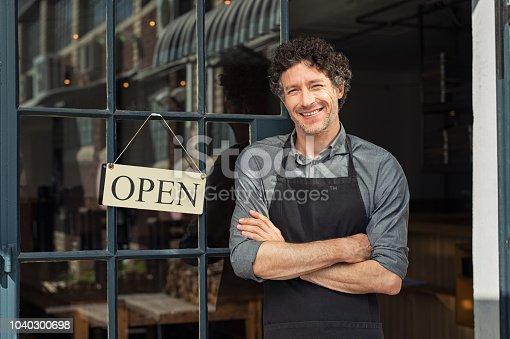 istock Owner standing outside restaurant 1040300698