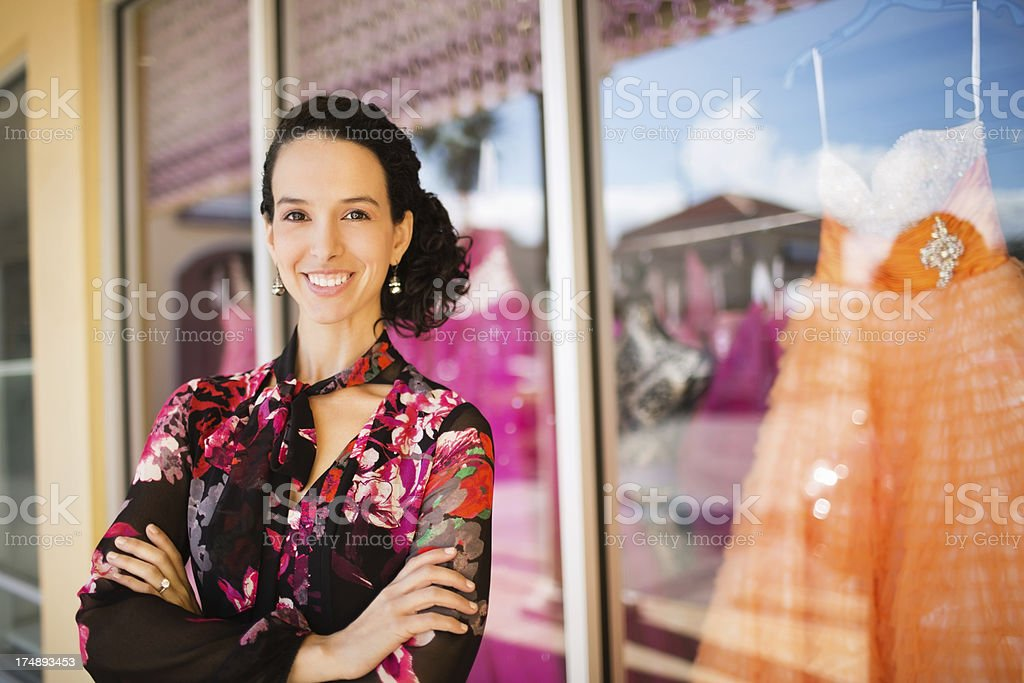 Owner Standing With Arms Crossed Outside Store royalty-free stock photo