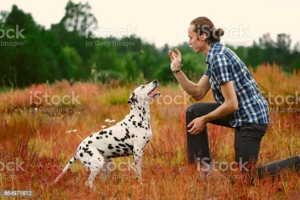 Owner with dog on field picture id854971612?b=1&k=6&m=854971612&s=612x612&h=kc8bnyxa9flshqft7s8ecad ikyexljkgnqvz4vupl0=