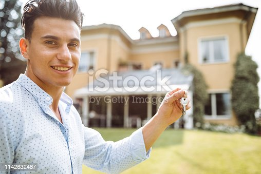 owner with house key close up