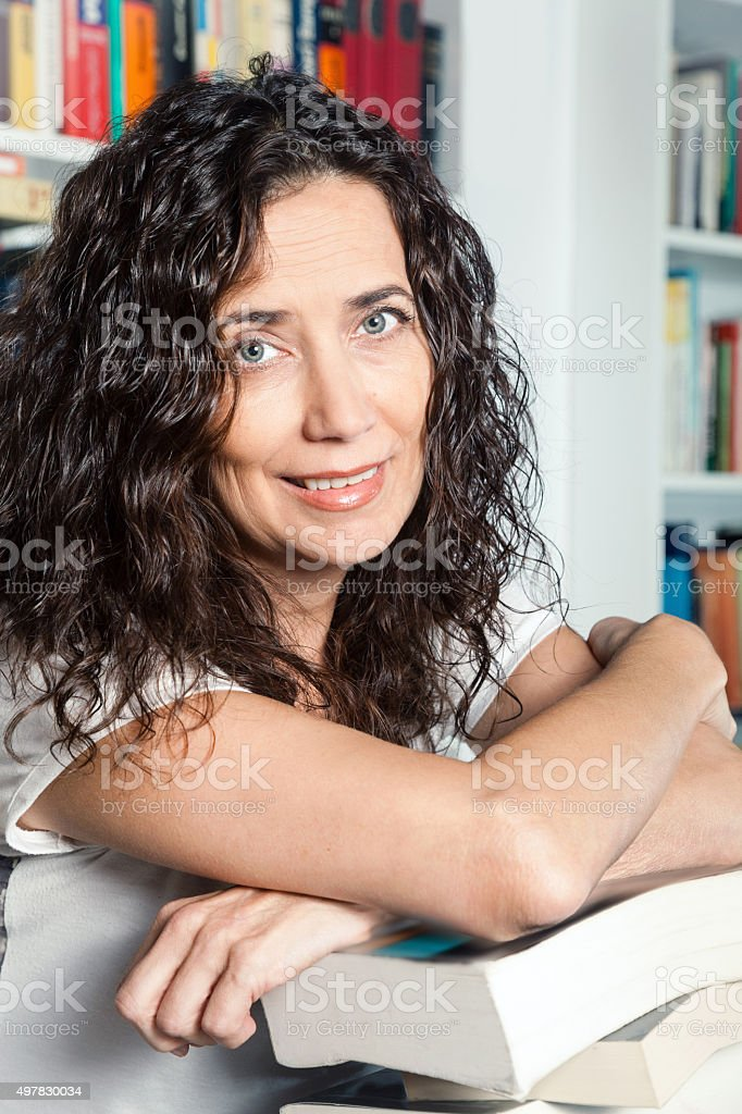 Owner woman in the bookstore stock photo