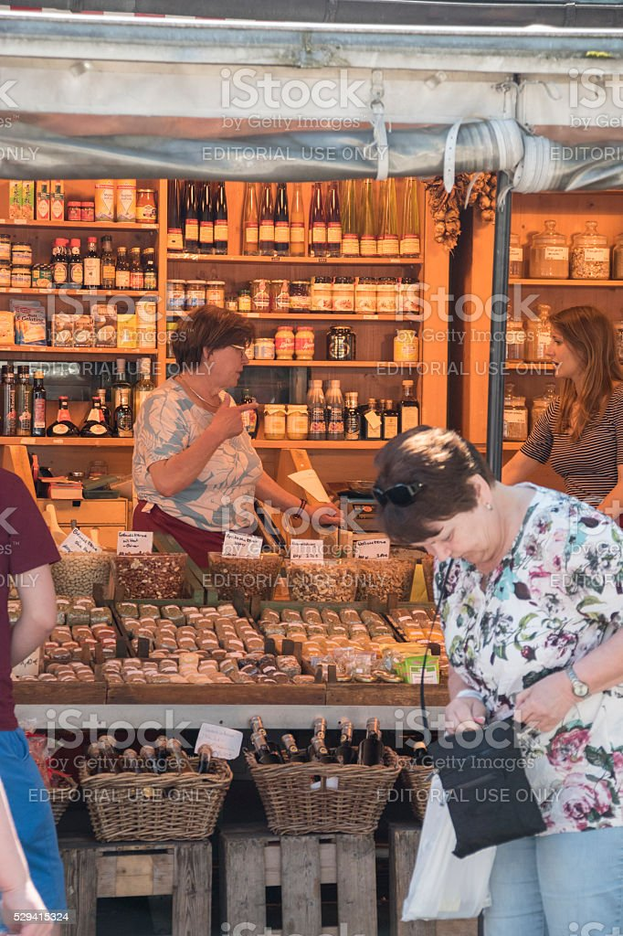 Owners and customers of a shop at Viktualienmarket, Munich stock photo