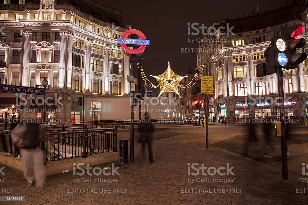oxford circus underground entrance at night in london england stock photo